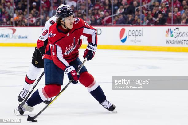 J Oshie of the Washington Capitals shoots the puck against Bobby Ryan of the Ottawa Senators in the first period at Capital One Arena on November 22...