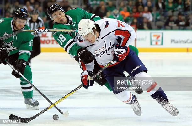 J Oshie of the Washington Capitals skates the puck against Tyler Pitlick of the Dallas Stars in the first period at American Airlines Center on...