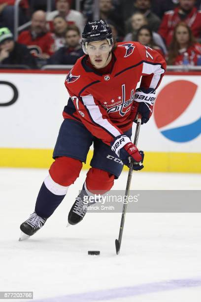 J Oshie of the Washington Capitals skates with the puck against the Calgary Flames during the third period at Capital One Arena on November 20 2017...