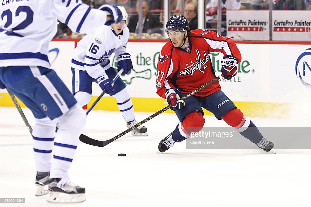 T.J. Oshie #77 of the Washington Capitals skates with the puck as Mitch Marner #16 of the Toronto Maple Leafs and Nikita Zaitsev #22 of the Toronto Maple Leafs defend in the first period at Verizon Center on January 3, 2017 in Washington, DC.