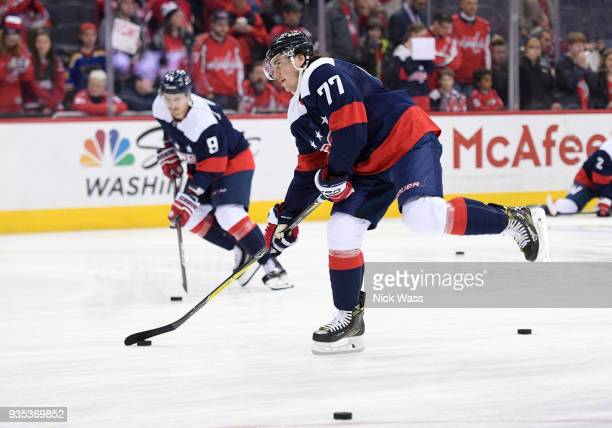 J Oshie of the Washington Capitals skates with the puck before a game against the Dallas Stars at Capital One Arena on March 20 2018 in Washington DC