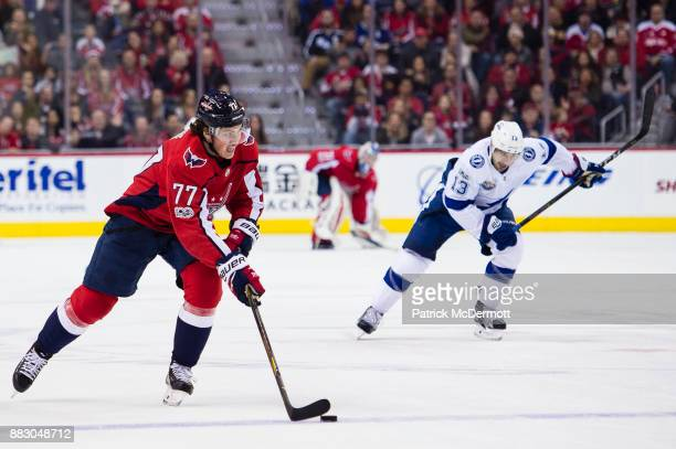 J Oshie of the Washington Capitals skates with the puck in the third period against the Tampa Bay Lightning at Capital One Arena on November 24 2017...