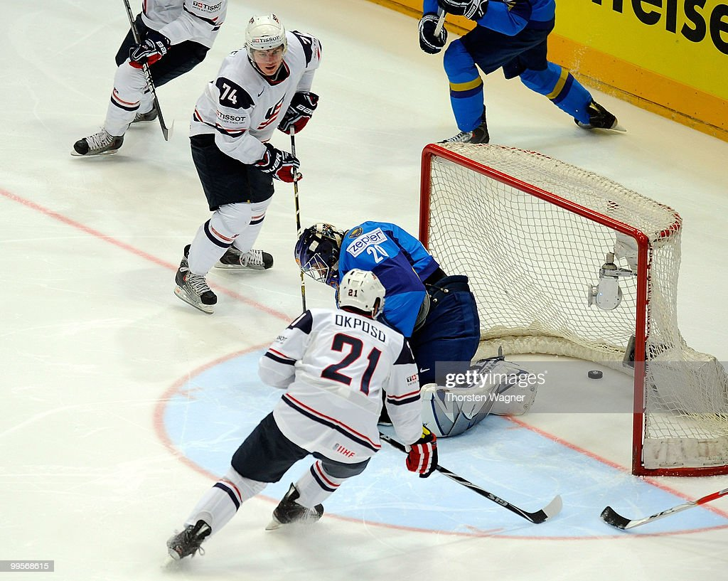 TJ Oshie (L) of United States is scoring the 1:0 during the IIHF World Championship final round match between USA and Kazakhstan at Lanxess Arena on May 15, 2010 in Cologne, Germany.