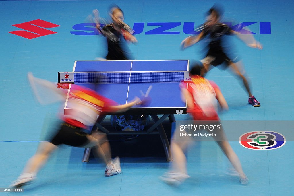 Oshima Yuya and Wakamiya Misako of Japan (black) compete against Fan Zhendong and Chen Meng of China (red) during Mixed doubles semi-final match of the 22nd 2015 ITTF Asian Table Tennis Championships at Pattaya Sports Indoor Stadium on October 1, 2015 in Pattaya, Thailand.