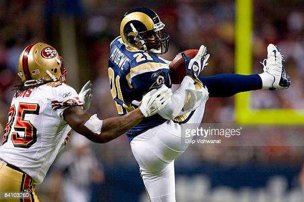 Oshiomogho Atogwe of the St Louis Rams intercepts a pass intended for Vernon Davis of the San Francisco 49ers at the Edward Jones Dome on December 21...