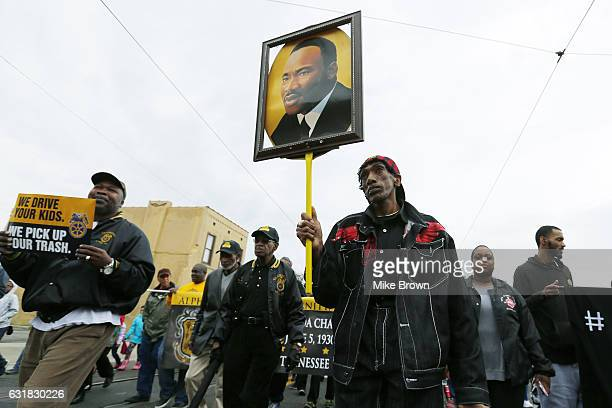 Osie James carries a picture or Dr Martin Luther King Jr during the annual Martin Luther King Day march on January 16 2017 in Memphis Tennessee...