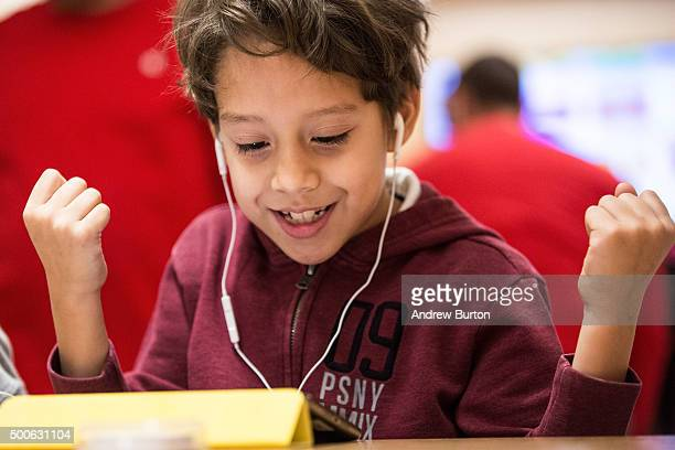 Osiel Dominguez a third grade student from PS 57 James Weldon Johnson Leadership Academy learns how to code at an Apple Store through Apple's Hour of...