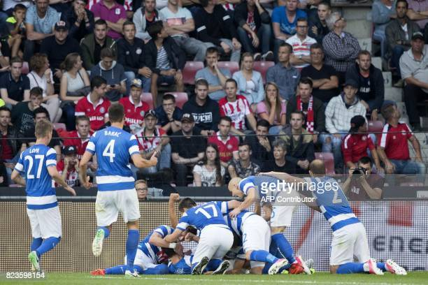 Osijek's players celebrate after scoring a goal during the UEFA Europa League qualifying football match between PSV Eindhoven and Osijek in Eindhoven...