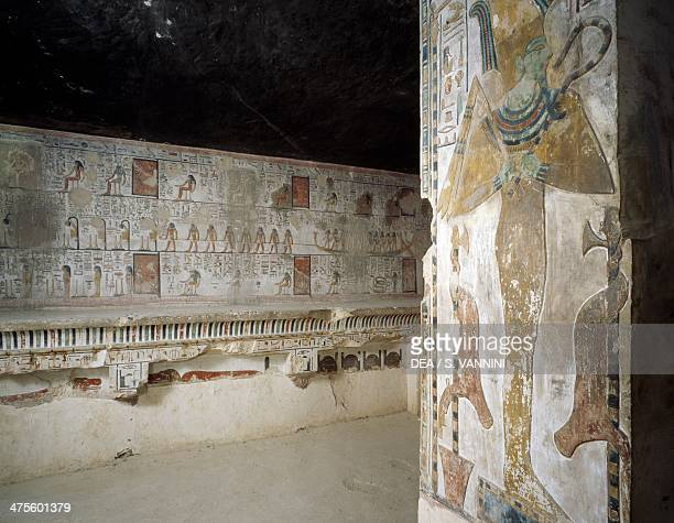 Osiris between two nkisi and animal skins hanging from two rods from the Book of Amduat detail from the frescoes in the Offering hall of the Tomb of...