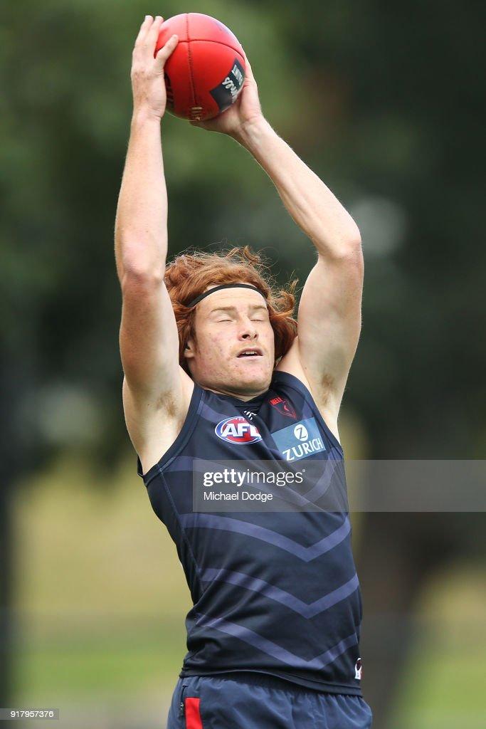 Oskar Baker marks the ball during a Melbourne Demons AFL training session at Gosch's Paddock on February 14, 2018 in Melbourne, Australia.