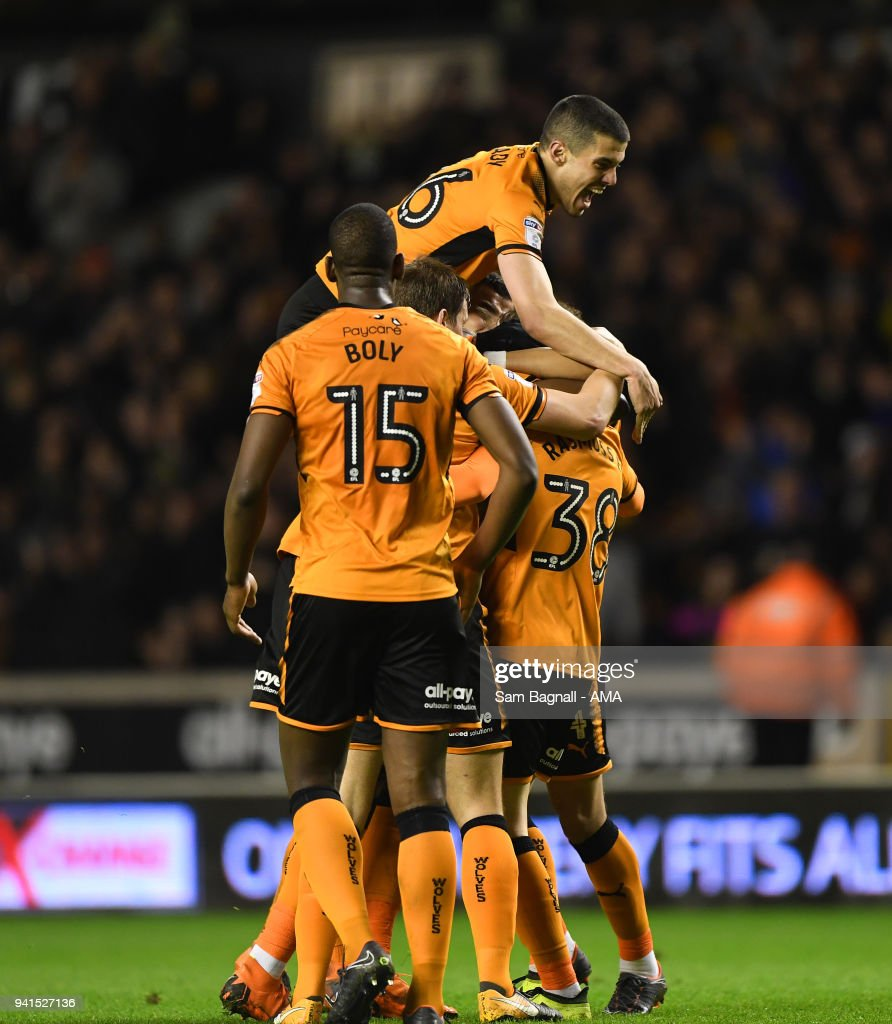 Oskar Buur Rasmussen of Wolverhampton Wanderers celebrates after scoring a goal to make it 2-2 with Conor Coady during the Sky Bet Championship match between Wolverhampton Wanderers and Hull City at Molineux on April 2, 2018 in Wolverhampton, England.