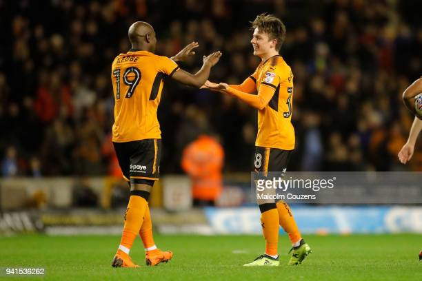 Oskar Buur Rasmussen of Wolverhampton Wanderers celebrates scoring a goal to make it 22 with Benik Afobe during the Sky Bet Championship match...