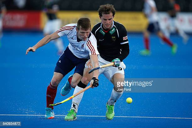 Oskar Deeck of Germany and Sam Ward of Great Britain battle for the ball during the FIH Men's Hero Hockey Champions Trophy 2016 match between Great...