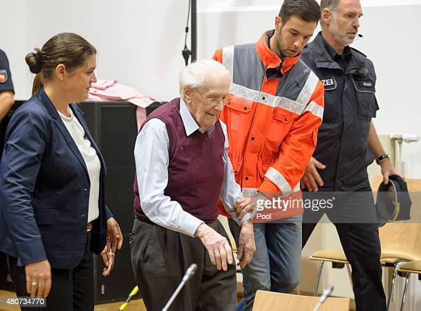 Oskar Groening a former member of the Waffen-SS who worked at the Auschwitz concentration camp during World War II, is helped into court by lawyer...