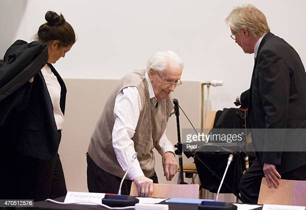 Oskar Groening and his lawyer Hans Holtermann arrive for the first day of his trial to face charges of being accomplice to the murder of 300000...