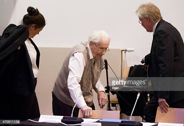 Oskar Groening arrives for the first day of his trial to face charges of being accomplice to the murder of 300,000 people at the Auschwitz...