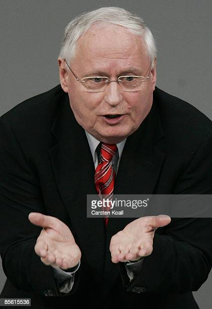 Oskar Lafontaine Co Chairman of the German far leftwing party Die Linke speaks after the government statement at the Bundestag ahead of the NATO...