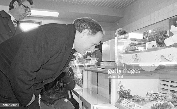 Oskar Lafontaine MinisterPresident of the state of Saarland visiting the GDR Lafontaine in a so called Delikatladen a shop for highpriced food and...