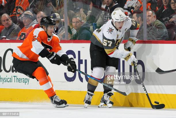 Oskar Lindblom of the Philadelphia Flyers battles along the boards for the loose puck with David Perron of the Vegas Golden Knights on March 12 2018...