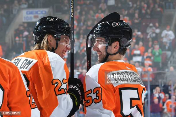 Oskar Lindblom of the Philadelphia Flyers gets congratulated by teammate Shayne Gostisbehere after a goal against the Ottawa Senators in the second...