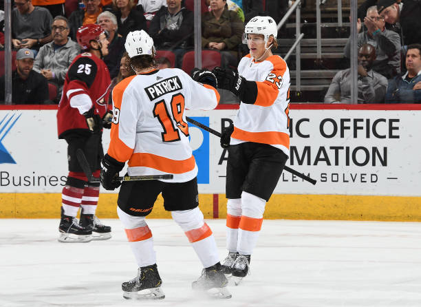 Oskar Lindblom of the Philadelphia Flyers is congratulated by teammate Nolan Patrick after scoring a goal against the Arizona Coyotes during the...