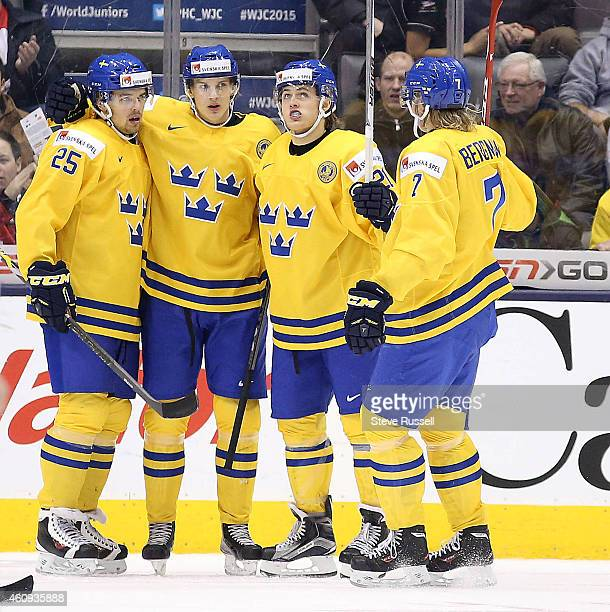 TORONTO ON DECEMBER 31 Oskar Lindblom second from left scored a hat trick he is congratulated by Axel Holmstrom William Nylander and Julius Bergman...