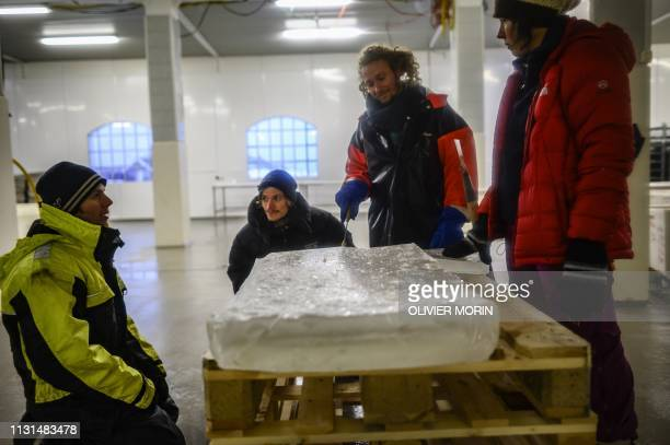 Oskar Nordin a 30yearold surfer from Sweden standing on the ice pack talks with Inge Tamburaci Wegge 32 about grip sensations at a fish factory in...