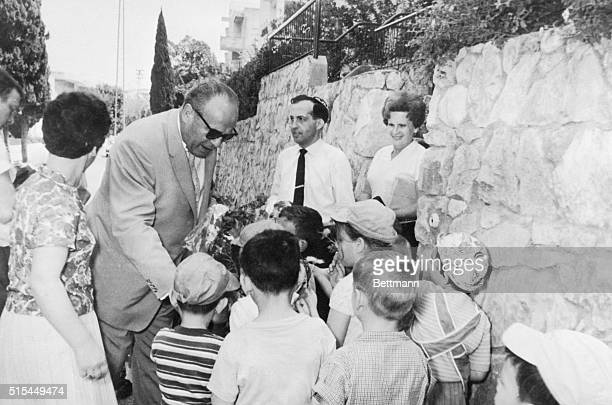 Oskar Schindler who saved many Jewish lives during the Nazi Holocaust in Germany talks to Israeli children in TelAviv in 1963