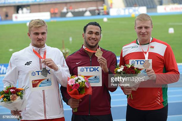 Oskar Stachnik from Poland Mohamed Ibrahim Moaaz from Qatar and Hleb Zhuk from Belarus on the podium in men's discus throw during the IAAF World U20...