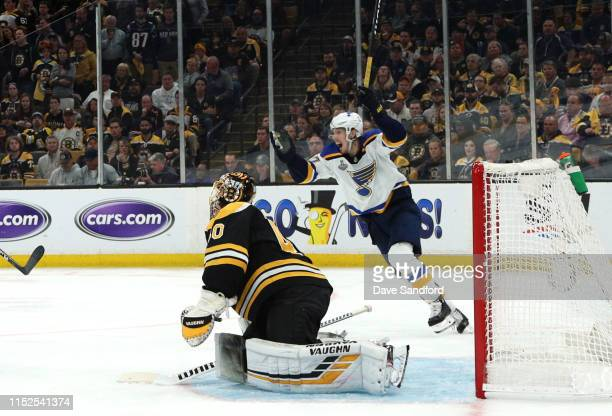 Oskar Sundqvist celebrates as goaltender Tuukka Rask of the Boston Bruins reacts in defeat after allowing the gamewinning overtime goal by Carl...