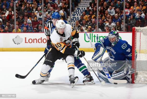 Oskar Sundqvist of the Pittsburgh Penguins takes a shot against Ryan Miller of the Vancouver Canucks during their NHL game at Rogers Arena March 11,...
