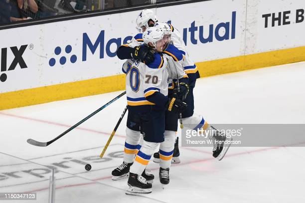 Oskar Sundqvist of the St Louis Blues celebrates with his teammates after scoring against the San Jose Sharks in the first period of Game Five of the...