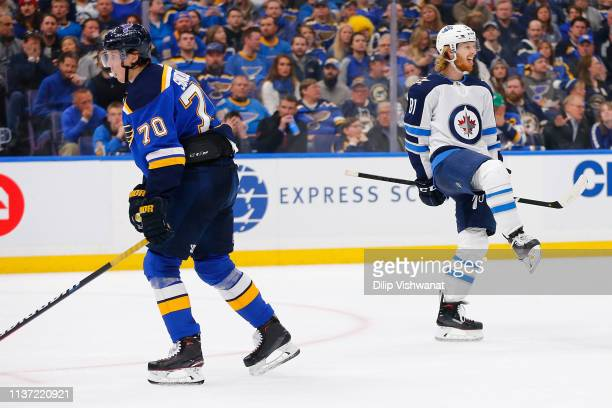 Oskar Sundqvist of the St Louis Blues reacts as Kyle Connor of the Winnipeg Jets celebrates after scoring a goal against the St Louis Blues in Game...