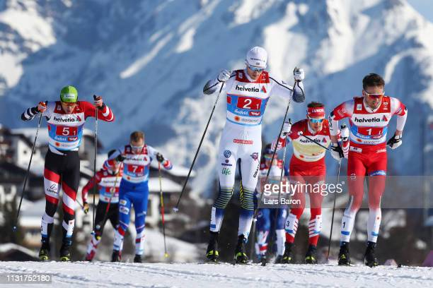 Oskar Svensson of Sweden Emil Iversen of Norway and Max Hauke of Austria competes in the first semifinal run for the Mens' Cross Country Team Sprint...