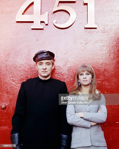 Oskar Werner Austrian actor and Julie Christie British actress pose beneath a large 451 sign issued as publicity for the film 'Fahrenheit 451' Great...