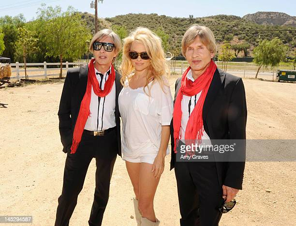 Oskar Wess Pamela Anderson and Arnold Wess visit The Gentle Barn on May 24 2012 in Santa Clarita California