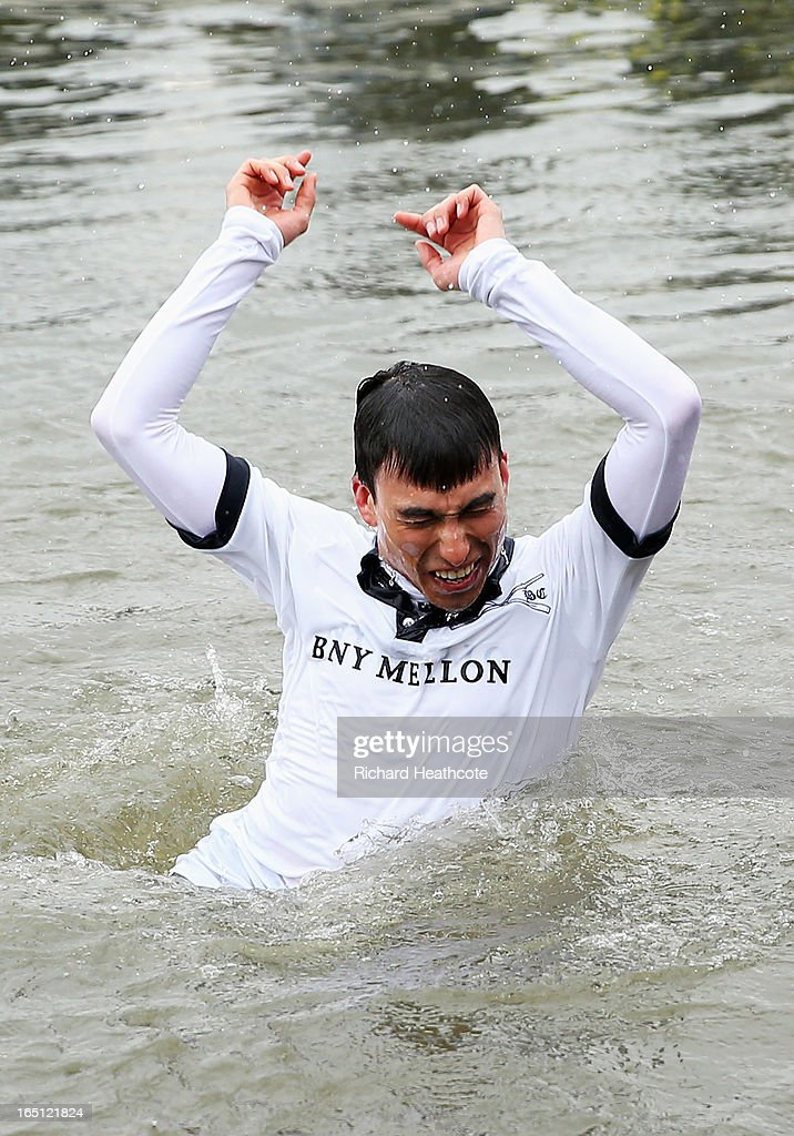Oskar Zorrilla of Oxford, the winning cox is thrown into the River Thames after the BNY Mellon 159th Oxford versus Cambridge University Boat Race on The River Thames on March 31, 2013 in London, England.