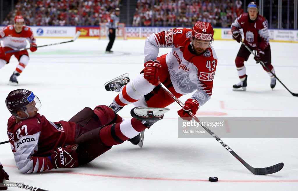 Oskars Cibulskis (L) of Latvia and Nichlas Hardt of Denmark battle for the puck during the 2018 IIHF Ice Hockey World Championship Group B game between Latvia and Denmark at Jyske Bank Boxen on May 15, 2018 in Herning, Denmark.