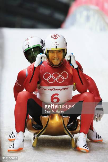 Oskars Gudramovics and Peteris Kalnins of Latvia react as they finish run 2 during the Luge Doubles on day five of the PyeongChang 2018 Winter...