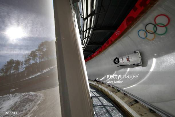 Oskars Kibermanis of Latvia trains during Bobsleigh practice ahead of the PyeongChang 2018 Winter Olympic Games at Olympic Sliding Centre on February...
