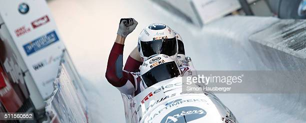 Oskars Melbardis Daumants Dreiskens Arvis Vilkaste and Janis Strenga from Latvia celebrate victory during the Men'ss FourMan Bobsleigh at Day 7 of...