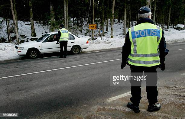 Police halt the traffic at the cordonedoff area outside the nuclear plant in Oskarshamn about 250 kilometers south of Stockholm Sweden 28 February...