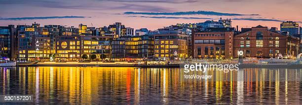 Oslo Aker Brygge waterfront crowds restaurants illuminated dusk panorama Norway