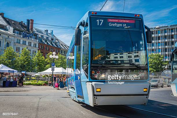 oslo city tram public transport rolling through stortorvet square norway - cable car stock pictures, royalty-free photos & images