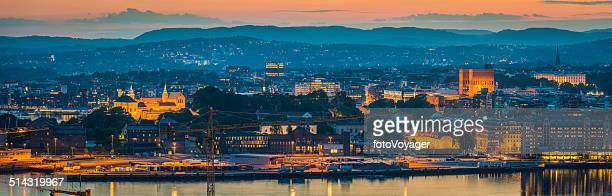 Oslo landmarks illuminated at sunset overloking harbour panorama Norway