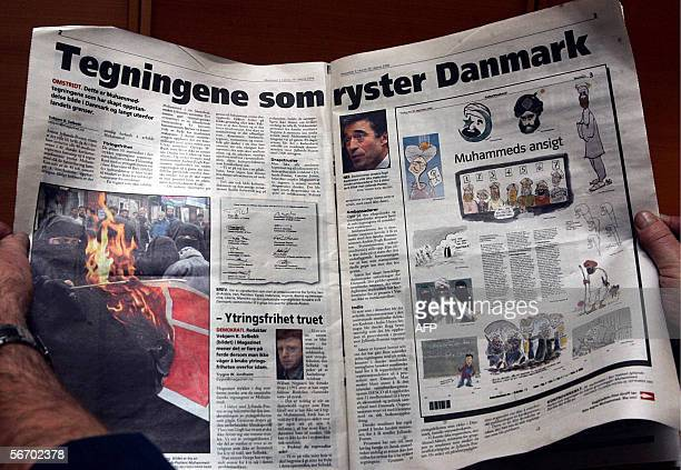 A picture taken 10 January 2006 in Oslo shows cartoons depicting Prophet Mohammed in the Christian weekly Magazinet Gunmen demonstrated 30 January...