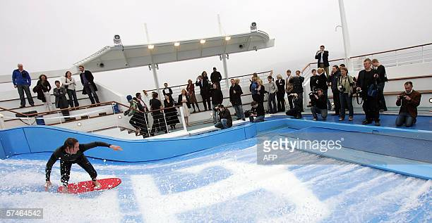 A surfer surfs the swimagainstthecurrent pool in which passengers can surf against a continuous flow of fastmoving water on the world's biggest...