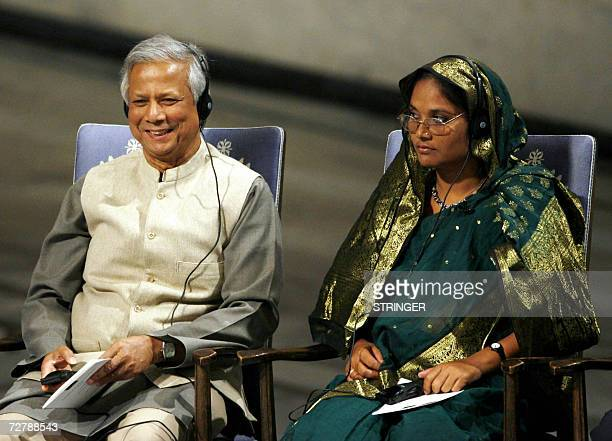 Nobel Peace laureate Muhammad Yunus and Grameen Bank representative Mosammat Taslima Begum listen to the chairman of the Norwegian Nobel Peace Prize...
