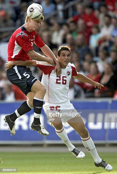 Norway's John Arne Riise vies with Switzerland's Philipp Degen during the friendly football Norway vs Switzerland at the Ullevaal Stadium in Oslo 17...