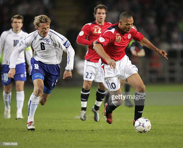 Norwegian John Carew runs the ball against Branislav Krunic in the first half of the Euro 2008 qualifying match in group C between Norway and...